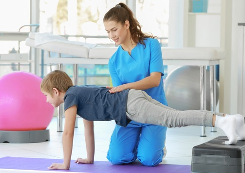 Physiotherapist with a child